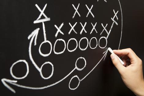 Setting a game plan for a team on chalkboard